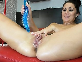Squirting latina fisting together with toying her pussy