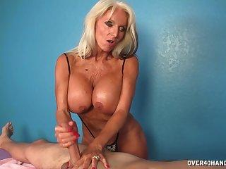 This matured woman gives him a handjob!