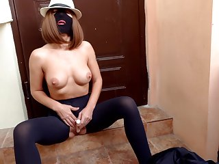 Whore In A Mask And Tight Black Pantyhose With A Hole In Their way Pussy Masturbates With A Vibrator Under